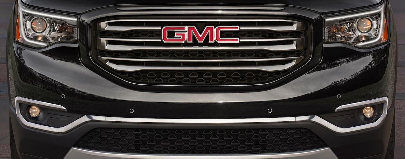 A closeup of a black 2019 GMC Acadia grille