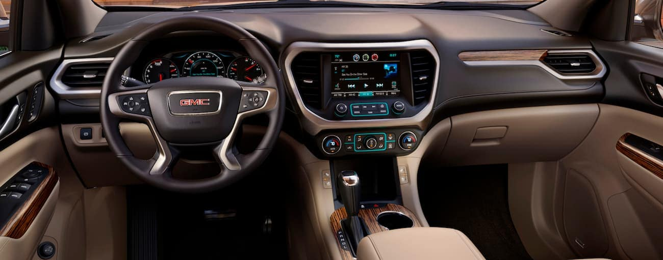 The two-tone brown leather interior of a 2018 GMC Acadia Denali