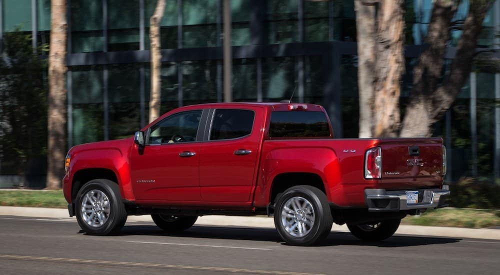 A red 2019 GMC Canyon parked on a city street