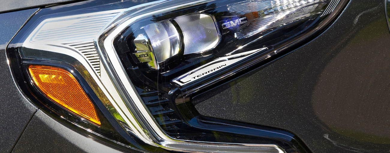 A closeup of a gray 2019 GMC Terrain headlight