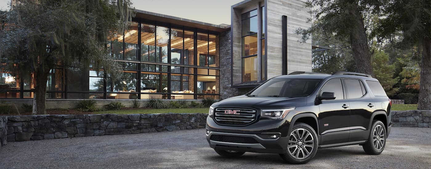 A black 2019 GMC Acadia outside a modern home in GA