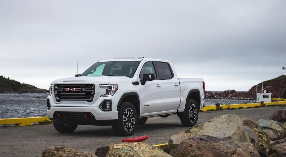 A white 2019 GMC Sierra on an ocean road