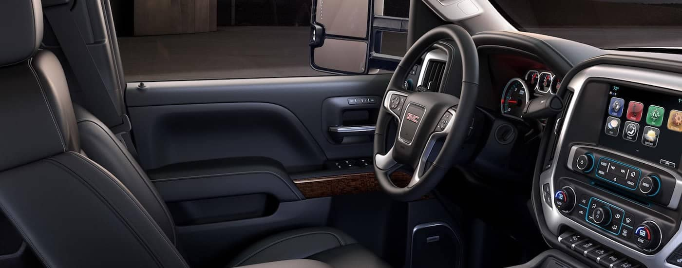 The black leather interior of a GMC truck for sale