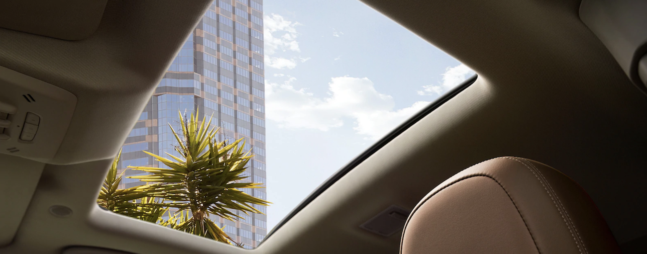 The large sunroom in the 2019 Buick Encore, open on a sunny summer day