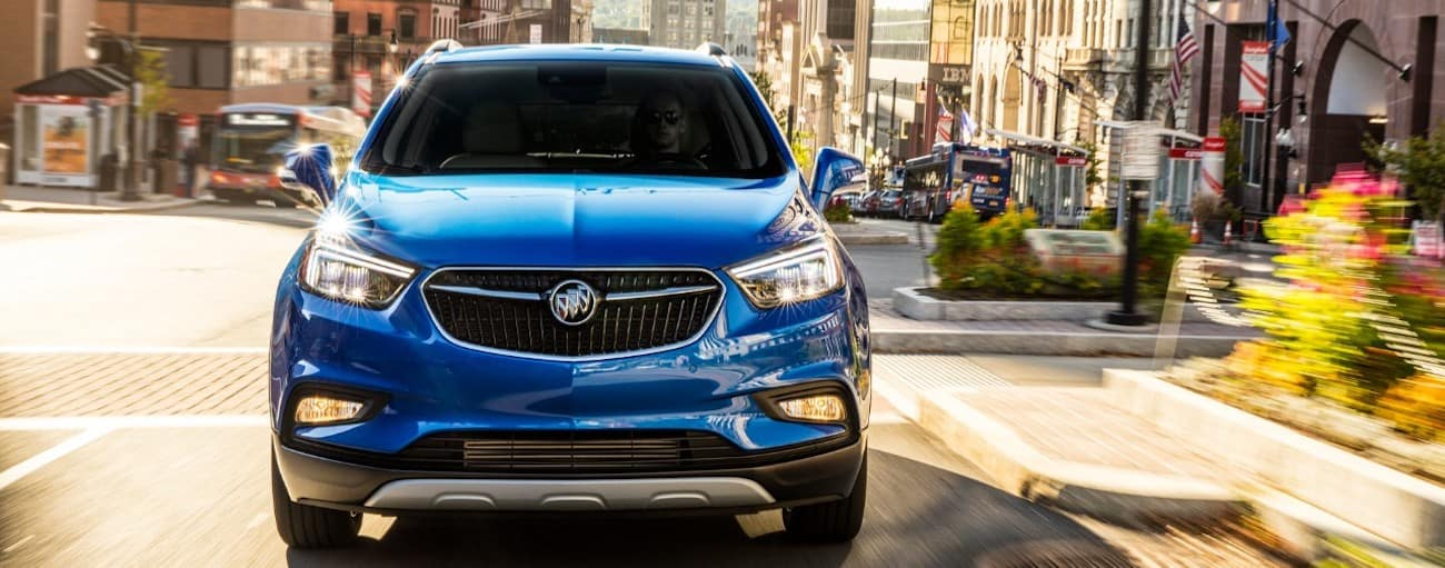A blue 2019 Buick Encore on a local test drive from a dealer