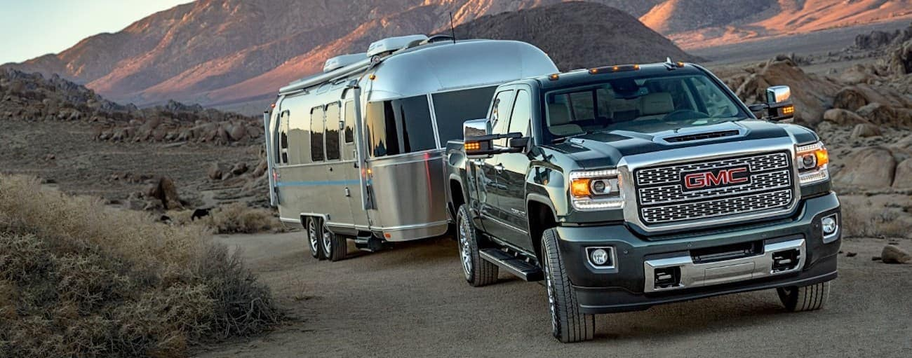 A 2019 GMC 2500HD Denali is towing an airstream trailer. WHen comparing performance for the 2019 GMC Sierra 2500 HD vs 2019 Ram 2500 HD, the GMC wins.