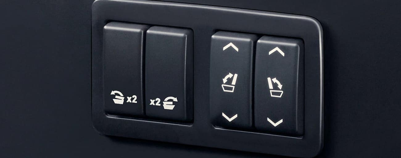 A look at the folding seat buttons that helped push the Yukon to win the 2019 GMC Yukon XL vs 2019 Ford Expedition EL