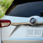 The back of a silver 2019 Buick Envision is shown.
