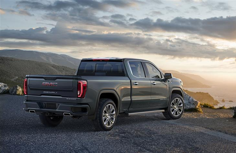 rear-side view of 2019 GMC Sierra 1500 looking out over mountain side