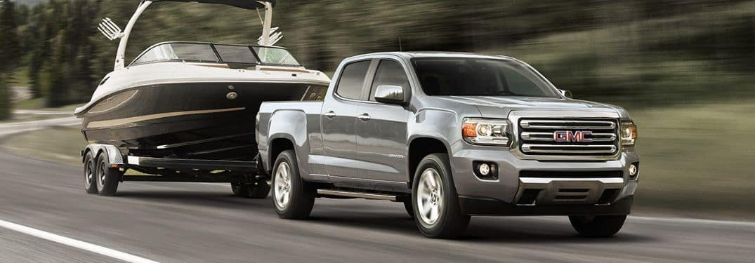 silver 2019 GMC Canyon towing boat