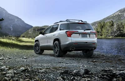 2020 GMC Acadia AT4 exterior back fascia and driver side in valley next to lake