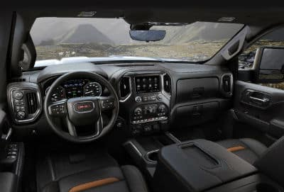 2020 GMC Sierra AT4 interior front cabin steering wheel and dashboard with mountains in window