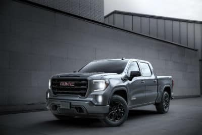 2020 GMC Sierra Elevation exterior front fascia and driver side in gray tiled room