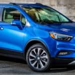 2019 Buick Encore exterior front fascia and passenger side in front of brick building