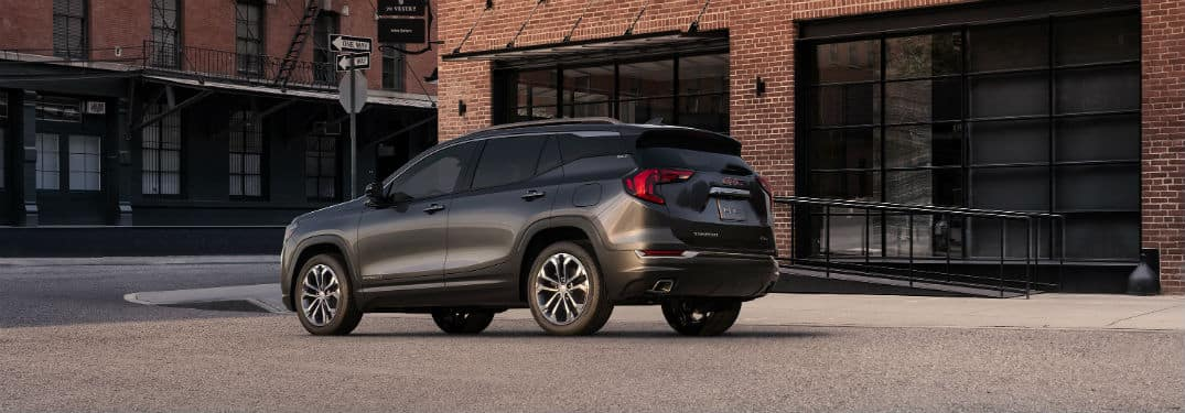2019 GMC Terrain SLT exterior back fascia and driver side in front of brick building