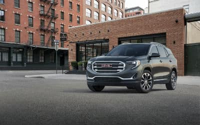 2019 GMC Terrain SLT exterior front fascia and driver side in front of apartment building garage