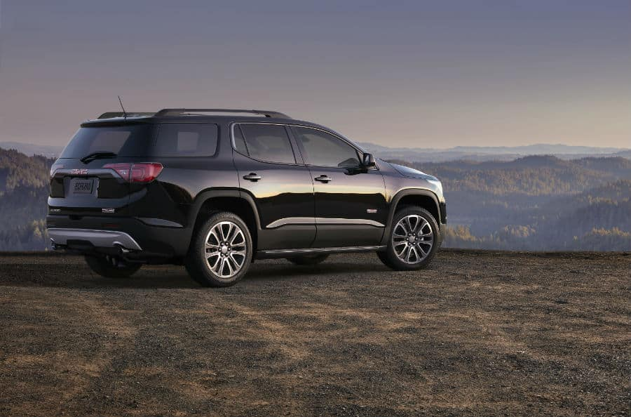 2019 GMC Acadia All Terrain exterior back fascia and passenger side on hill