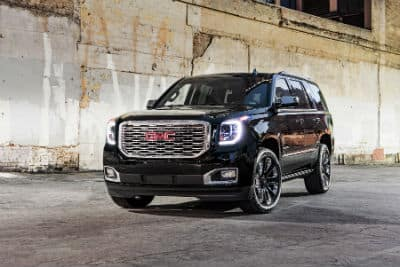 2019 GMC Yukon Denali exterior front fascia and driver side in front of brick wall