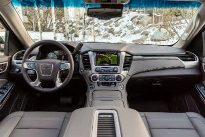 2019 GMC Yukon Denali interior front cabin direct view of steering wheel and dashboard with snow in window