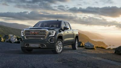 2020 GMC Sierra Denali exterior front fascia and driver side on mountain overlook