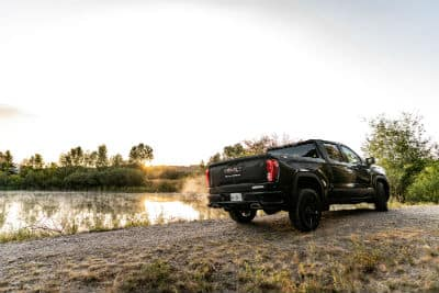 2020-GMC-Sierra-Elevation exterior back fascia and passenger side in front of lake