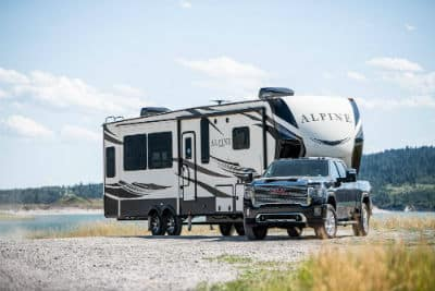 2020 GMC Sierra HD Denali exterior front fascia and passenger side towing camper