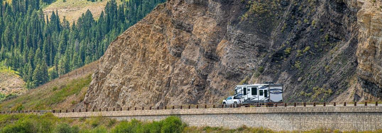 2020 GMC Sierra HD Denali exterior towing trailer in distance