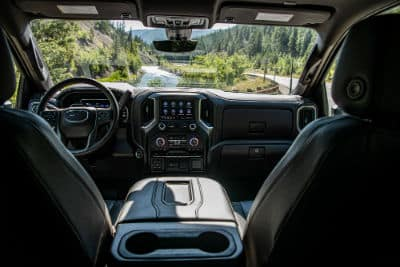 2020 GMC Sierra HD Denali interior front cabin looking past seats with steering wheel dashboard