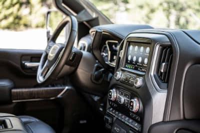 2020 GMC Sierra HD Denali interior front cabin steering wheel and partial dashboard
