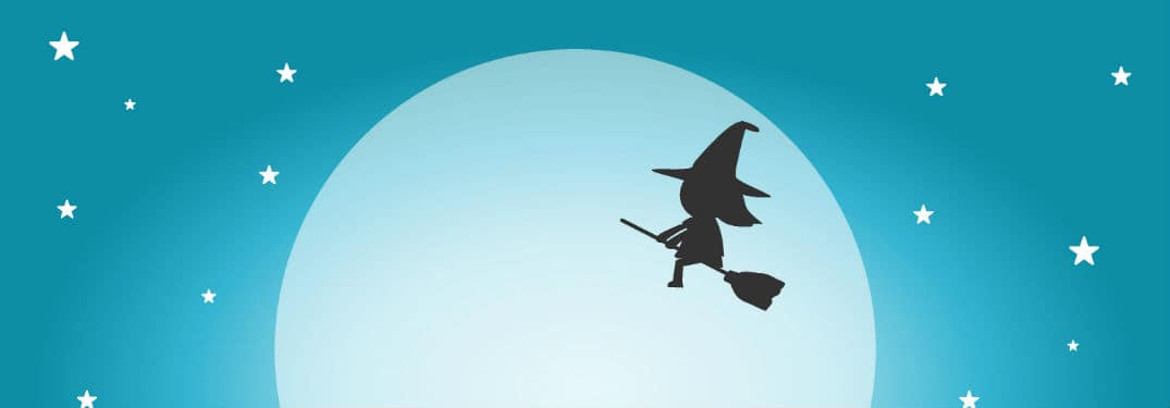 Witch on broomstick in front of large moon and stars with blue sky