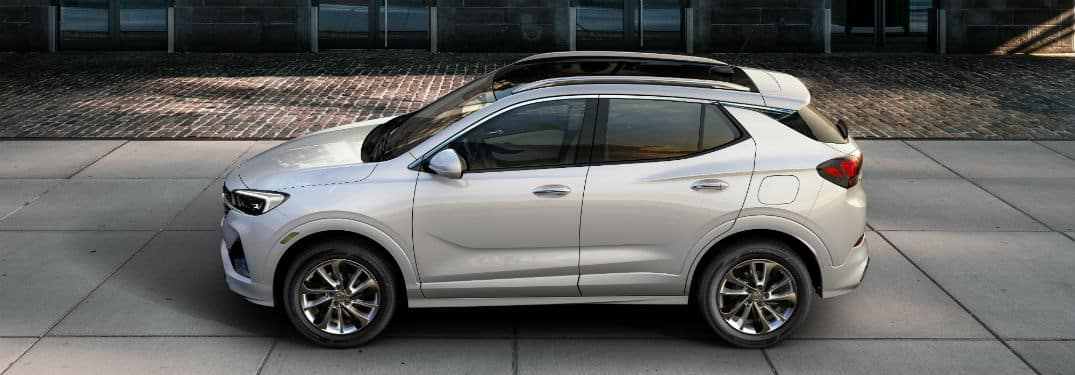 2020 Buick Encore GX exterior driver side profile on tiled road next to glass building