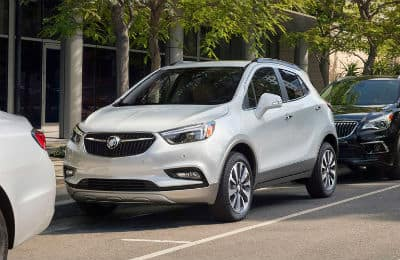 2020-Buick-Encore exterior front fascia and driver side parallel parked on side of road