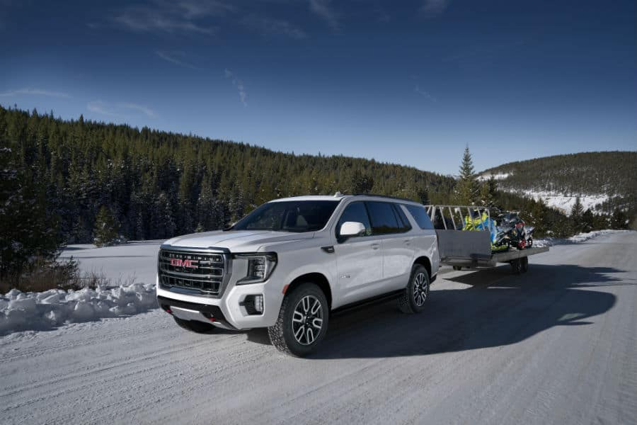 2021 GMC Yukon AT4 Exterior Driver Side Front Profile while Towing