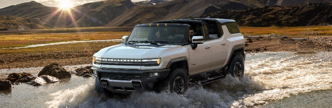 2024 GMC HUMMER EV SUV Exterior Driver Side Front Profile Fording through Water