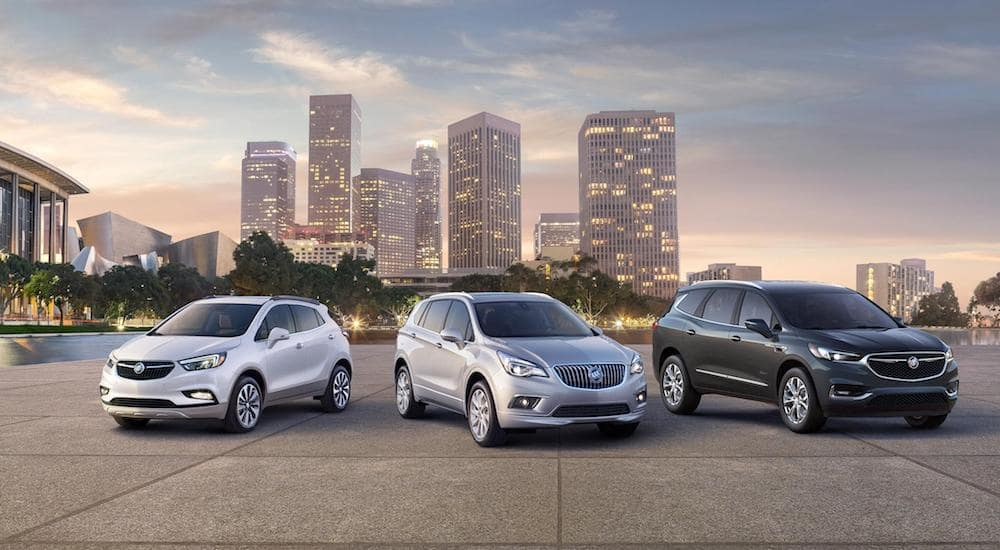 2018 Buick Corssover SUVs in front of a city skyline