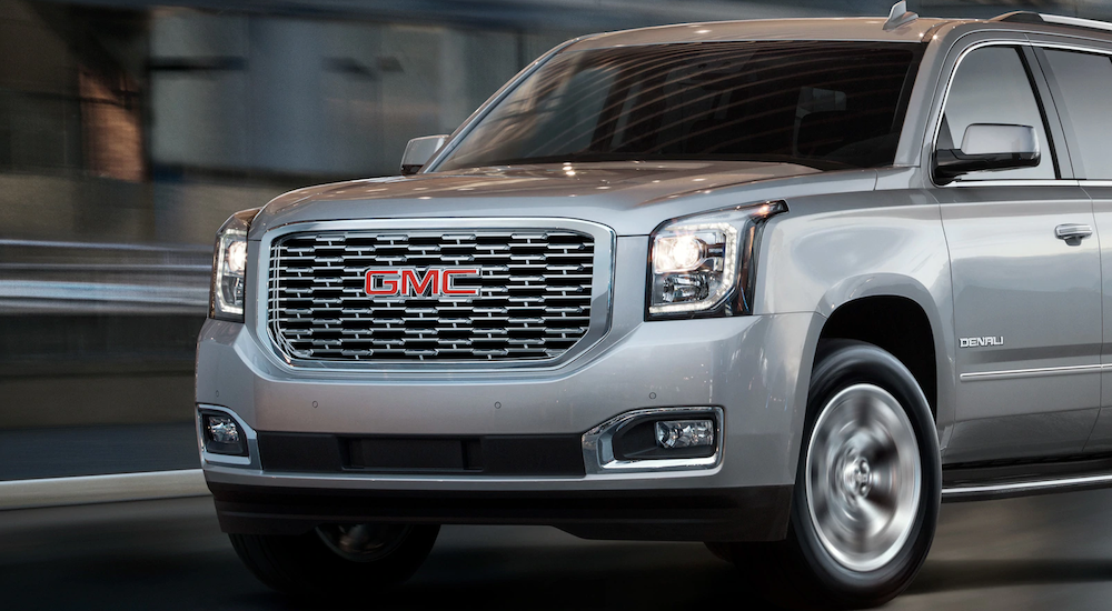 Gray 2018 GMC yukon denali driving front end