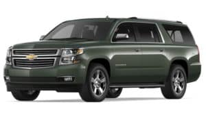 Green 2019 Chevy Suburban on white