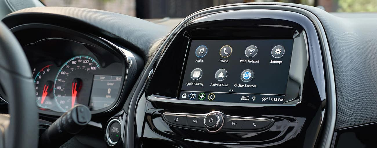 A closeup of a black interior and touch screen in a 2019 Chevy Spark
