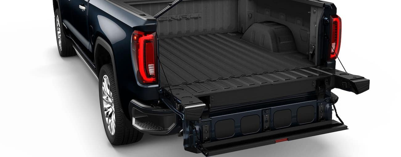 A closeup of the 2019 GMC Sierra's Multipro tailgate fully open