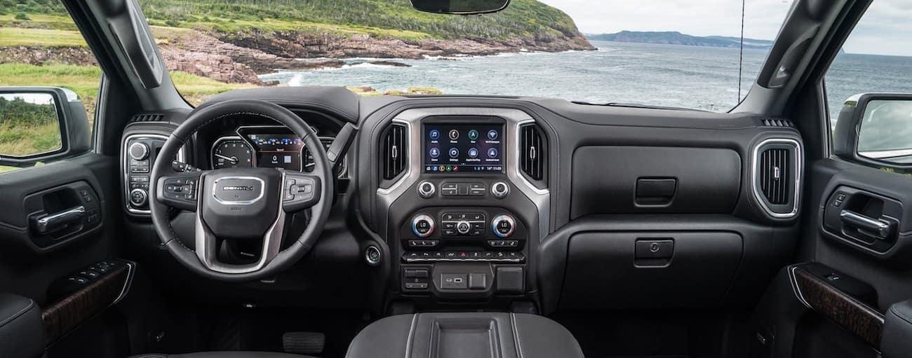 The black interior of a 2019 GMC Sierra Denali overlooking the ocean