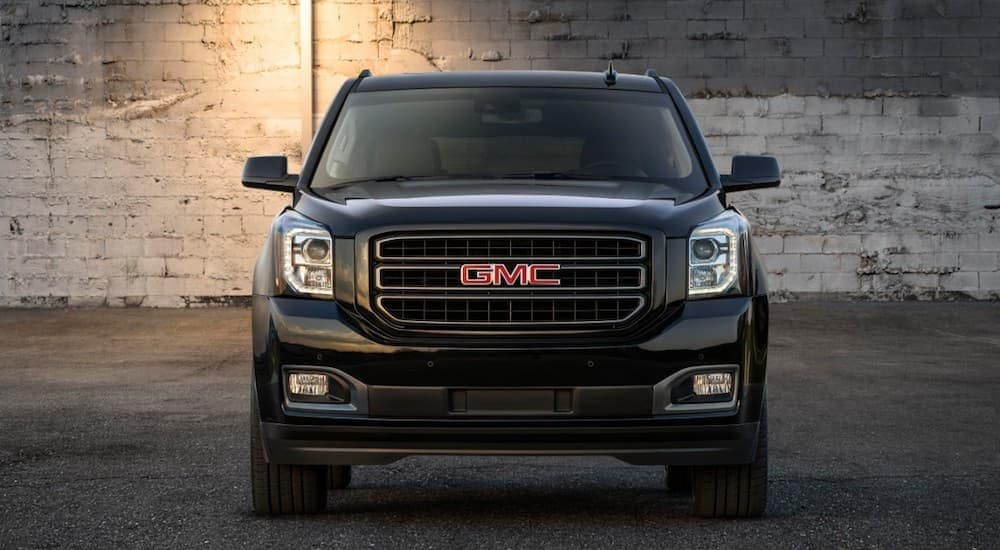 A black 2019 GMC Yukon in a parking garage from the front