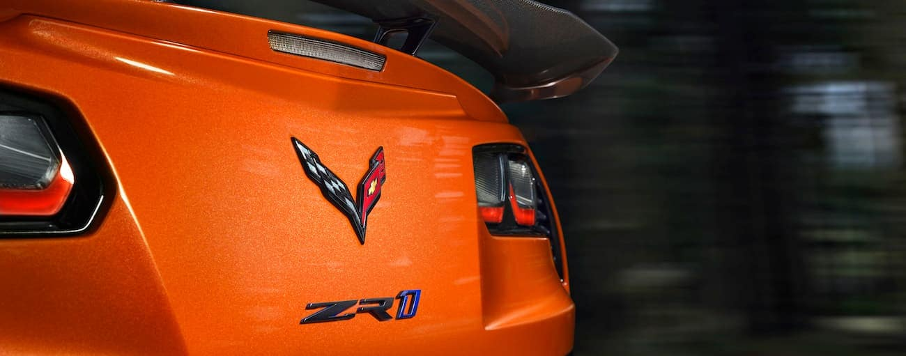 A closeup of the rear badging on an orange 2019 Chevy Corvette ZR1