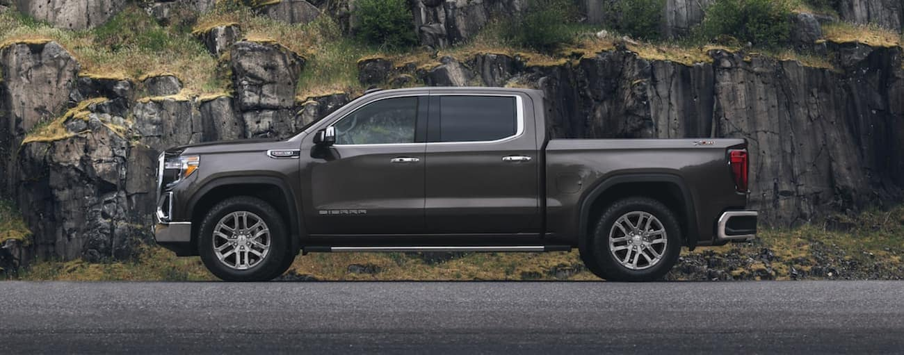 A gray 2019 GMC Sierra in front of a cliff