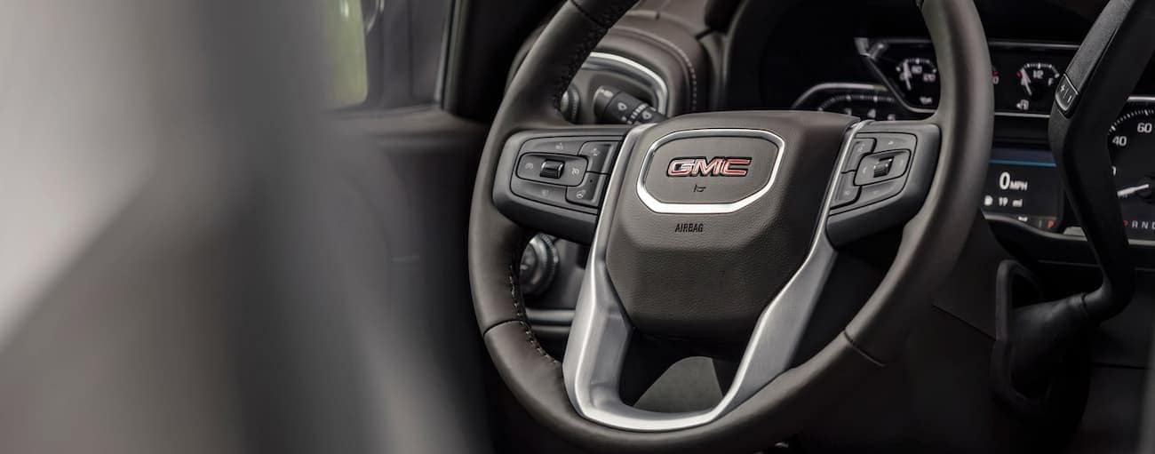 A closeup of a 2019 GMC Sierra steering wheel