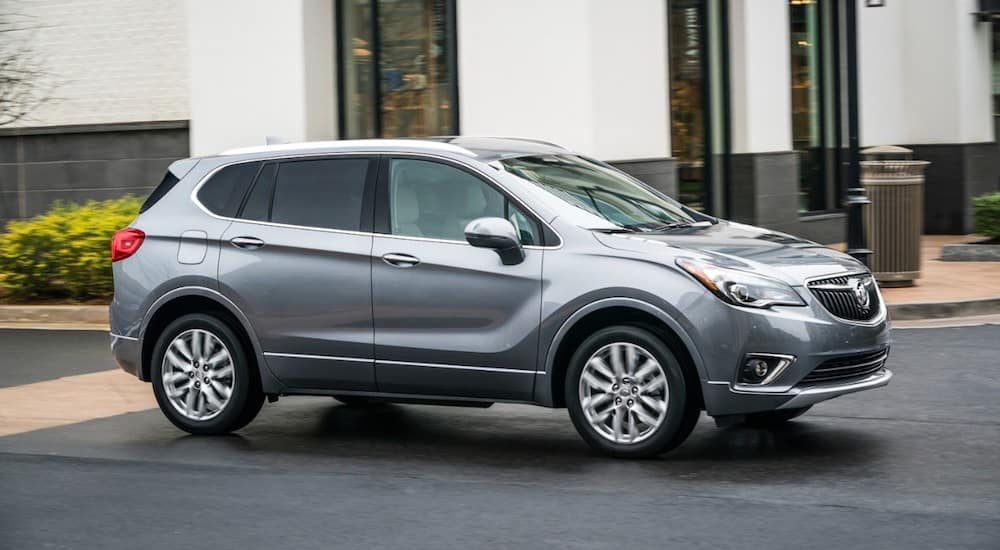A gray 2019 Buick Envision driving on a city street