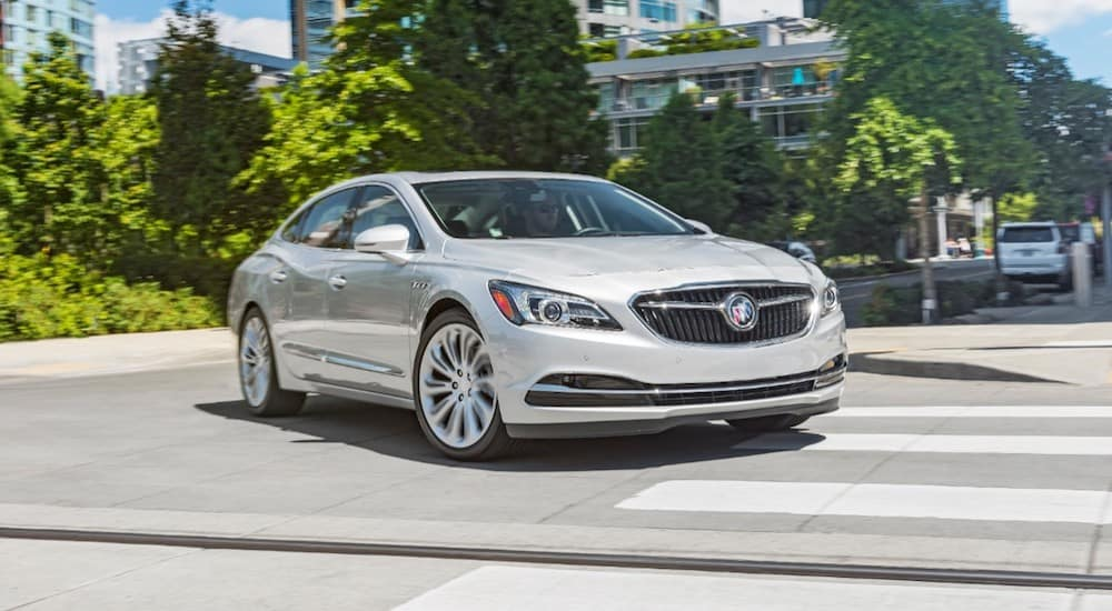 A silver 2019 Buick LaCrosse driving leaving a Buick dealership near me