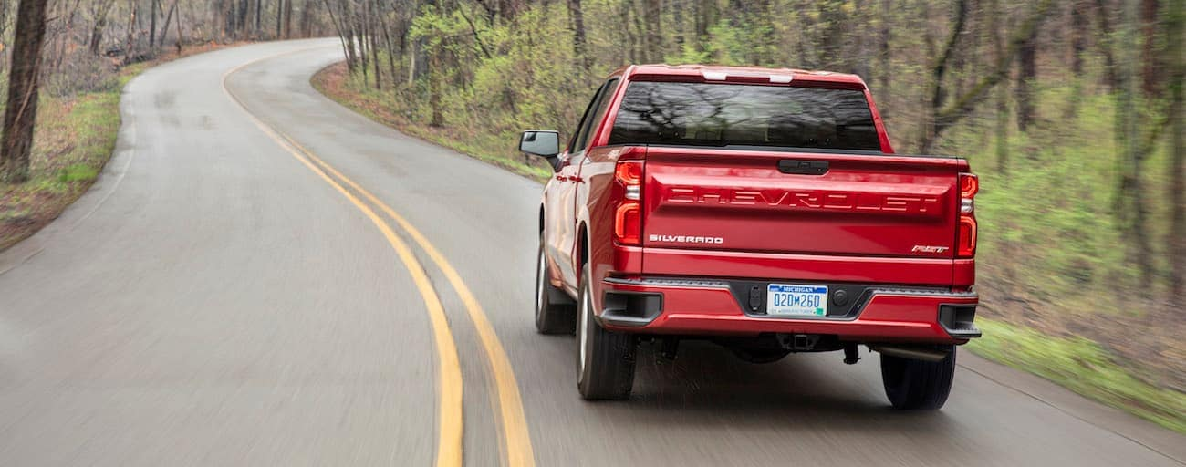 The back end of a red Chevy driving away with the win for 2019 Chevy Silverado vs 2019 Nissan Titan