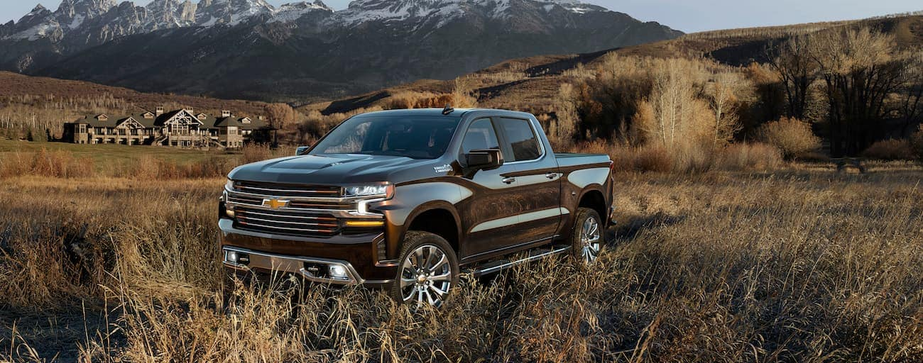 A brown Chevy stands alone in the prairie having won 2019 Chevy Silverado vs 2019 Ford F-150