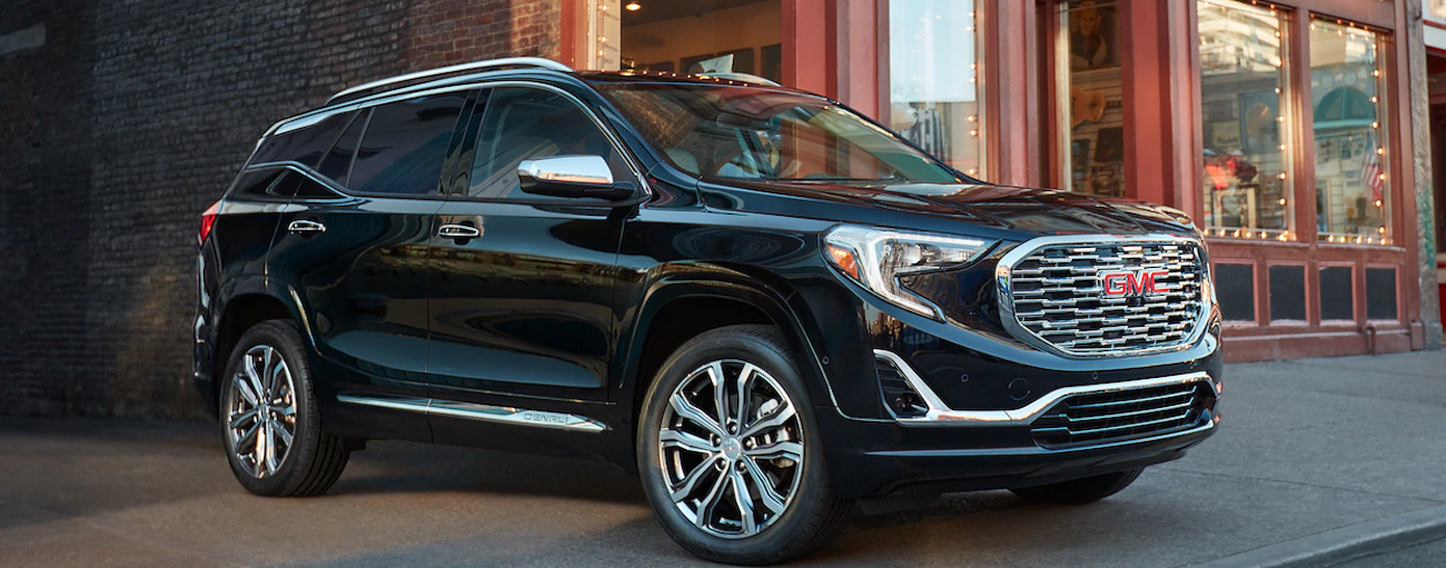 A black 2019 GMC Terrain outside a small local cafe