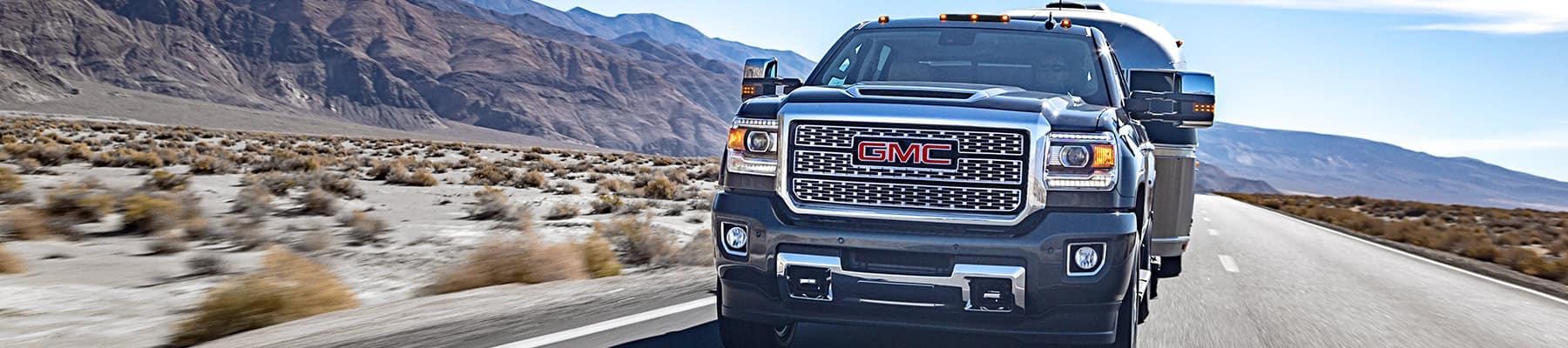2019 GMc 2500 Hd Sierra driving down a road